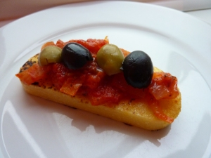 Polenta with tomato sauce & olives